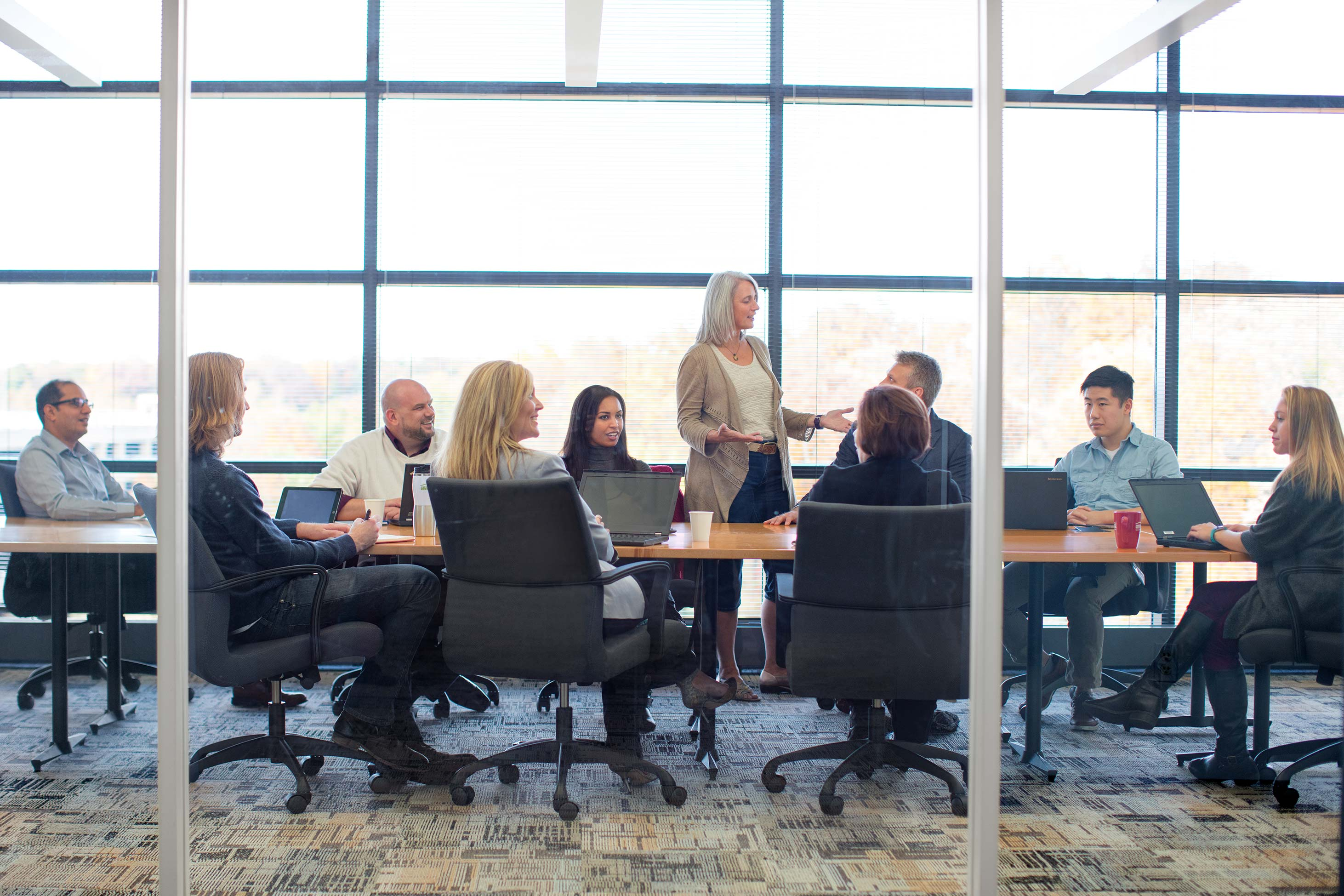 Co workers discussing strategy for business products