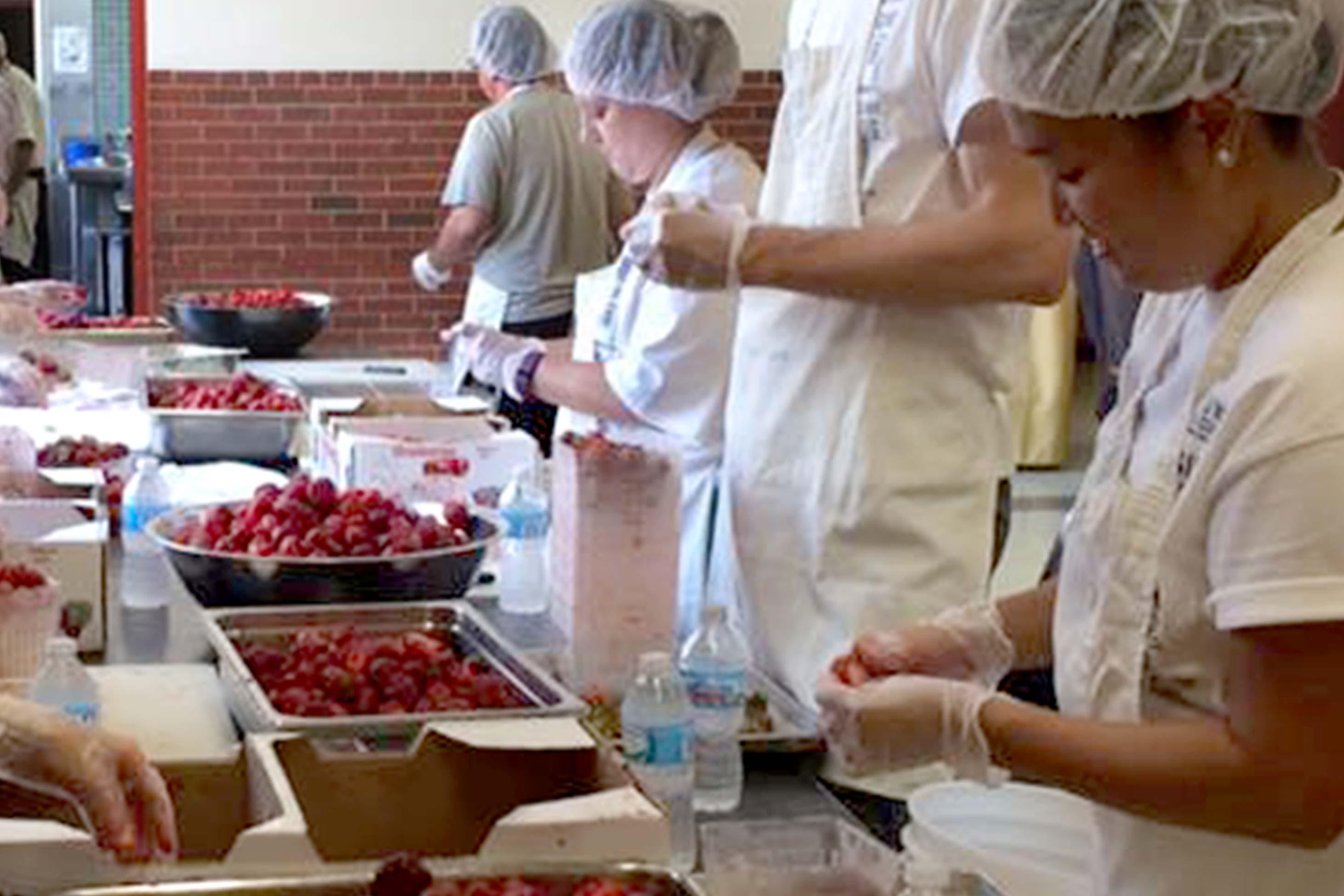 Employees working hard, sorting through food