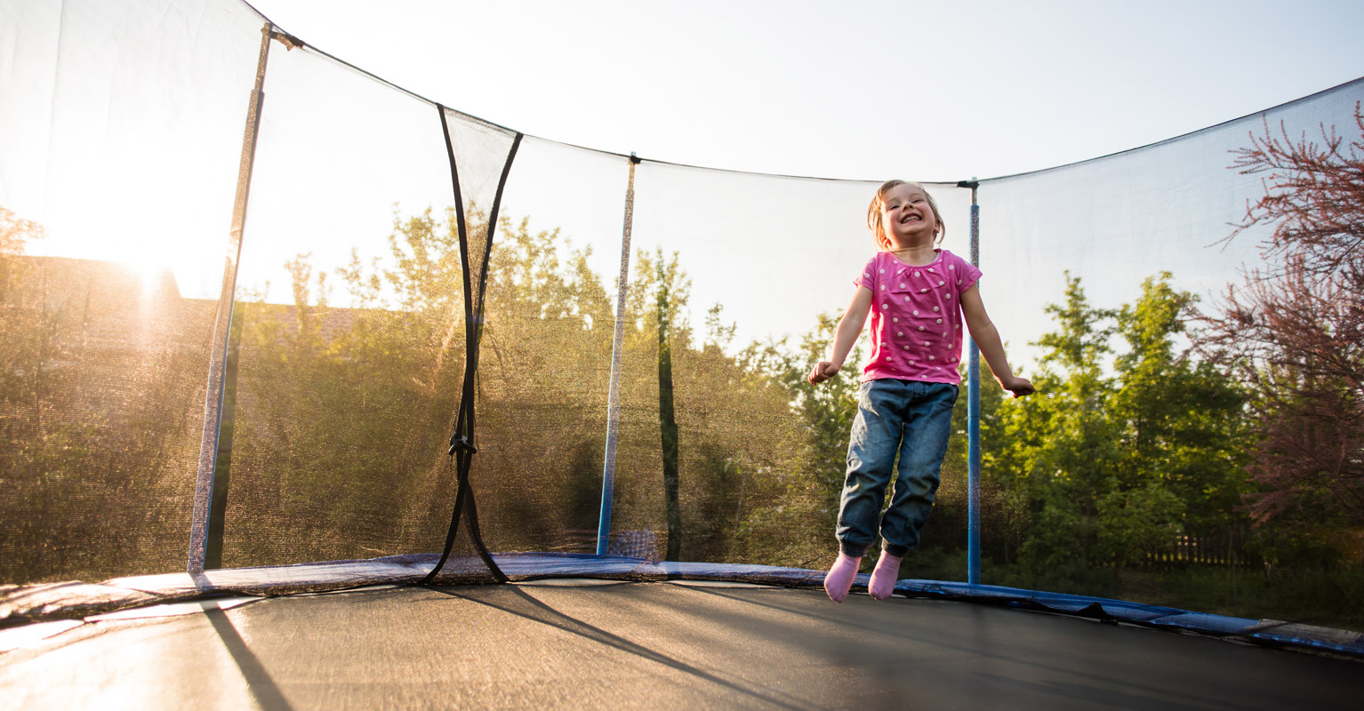 A child playing on a trampoline