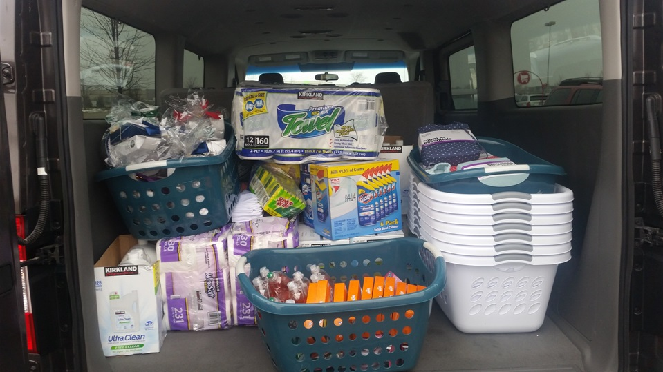 Photo of car full of cleaning supplies, paper goods and other donations for a shelter program. Check with your local shelter or housing program before donating items! Photo courtesy of YWCA Madison.